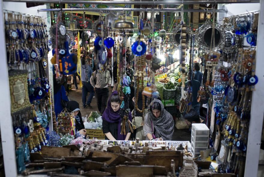 Women check out handmade jewelry at Tehran's Tajrish market.