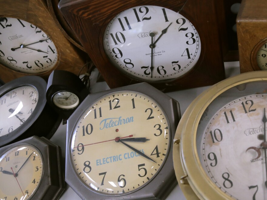 In this March 5 photo, antique clocks are displayed at the Electric Time Company in Medfield, Mass. Daylight saving time returns Sunday at 2 a.m. local time.