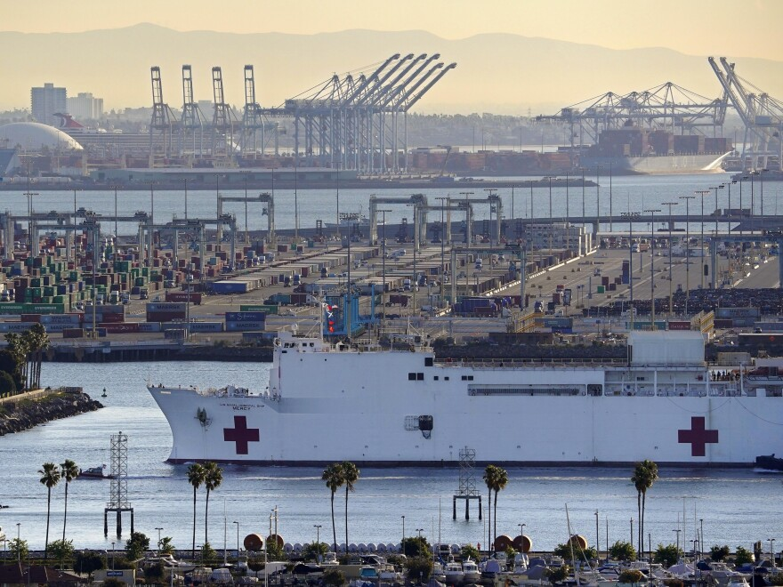 Prosecutors say the USNS Mercy, seen last week entering the Port of Los Angeles, was the target of a train engineer's unsuccessful attack on Tuesday. The derailed train slid to a halt more than 250 yards from the hospital ship. The Mercy was unharmed, and no one was injured.
