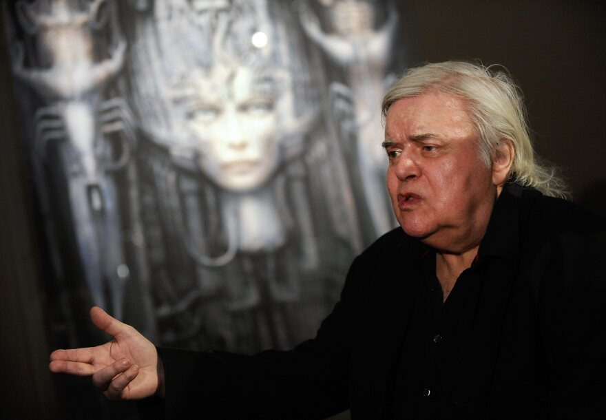"""Swiss artist H.R. Giger, seen here at his """"Dreams and Visions"""" exhibition in 2011, died Monday after a fall in Zurich. Giger's work includes designs for the 1979 film <em>Alien</em>."""