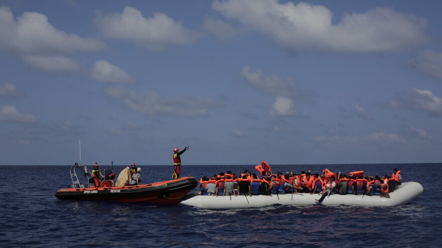 Migrants wait to be rescued from a rubber dinghy by members of the Spanish non-governmental organization Proactiva Open Arms during an operation on the Mediterranean Sea last September.