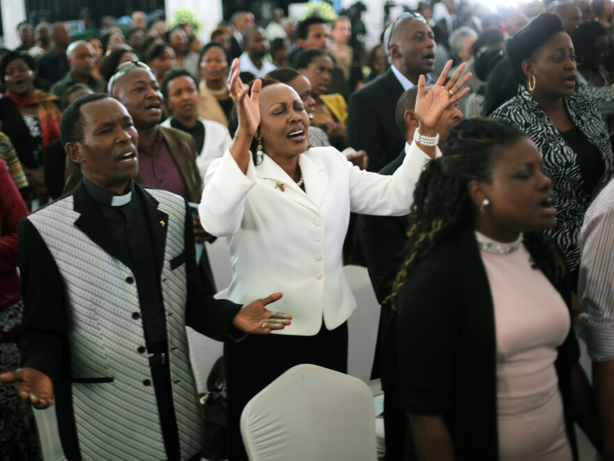 Friends and relatives of Mbugua Mwangi and his fiancee Rosemary Wahito attended their funeral service Friday in Nairobi, Kenya. Mwangi, who was Kenyan President Uhuru Kenyatta's nephew, and Wahito died in the Westgate Mall attack.