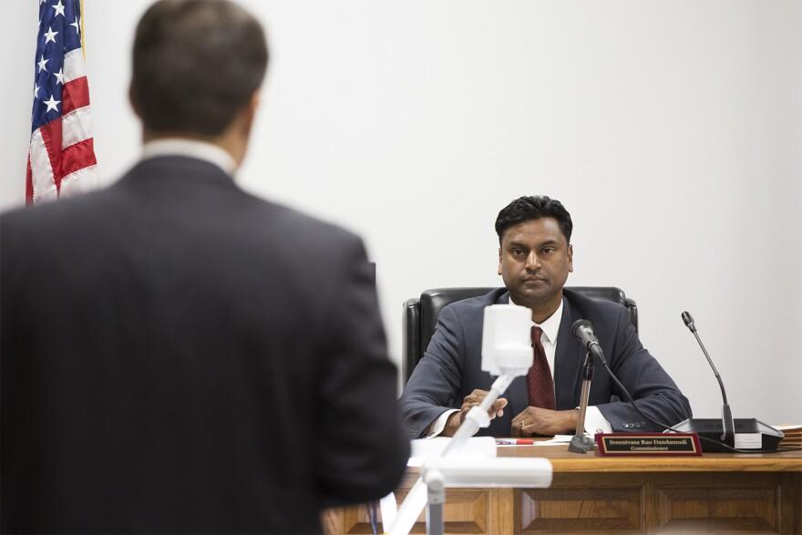 Commissioner Sreenivasa Rao Dandamudi listens to opening remarks from Missouri Solicitor General John Sauer. Oct. 28, 2019