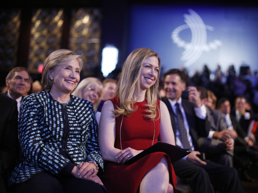 Clinton and her daughter, Chelsea, listen to President Obama and former President Bill Clinton speak at the Clinton Global Initiative on Tuesday.