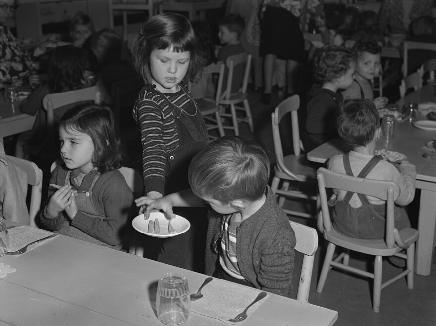 The scene in 1943 at a war workers' nursery in Oakland, Calif., where children were served cod liver oil and tomato juice in the morning, a nourishing lunch midday, and milk and crackers in the afternoon.