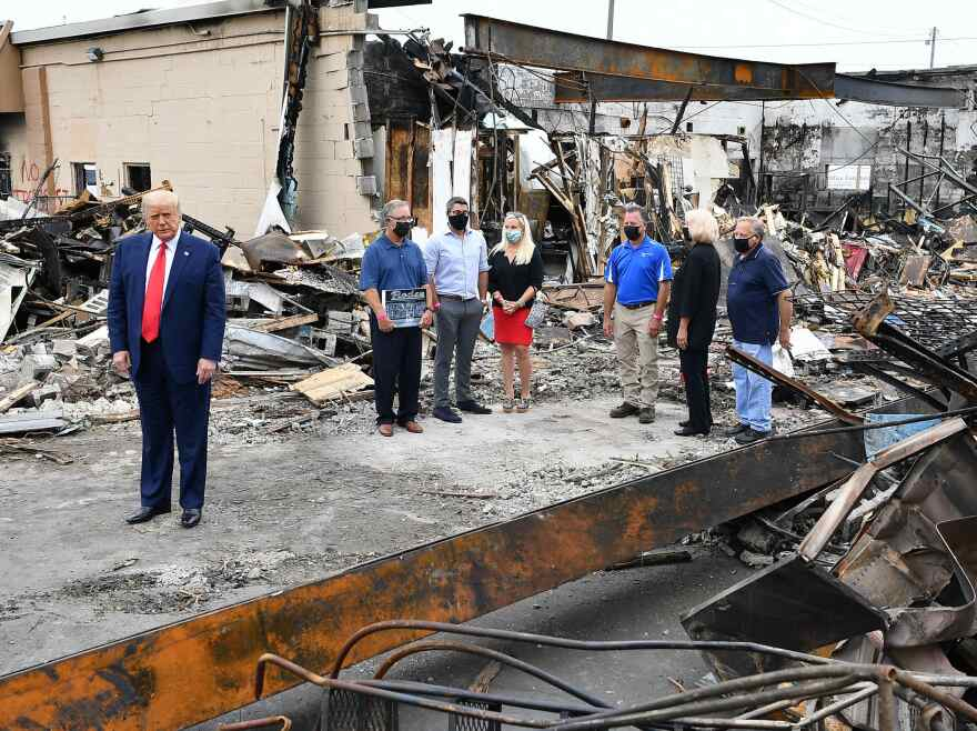 US President Donald Trump tours an area affected by civil unrest in Kenosha, Wisconsin on September 1, 2020. -