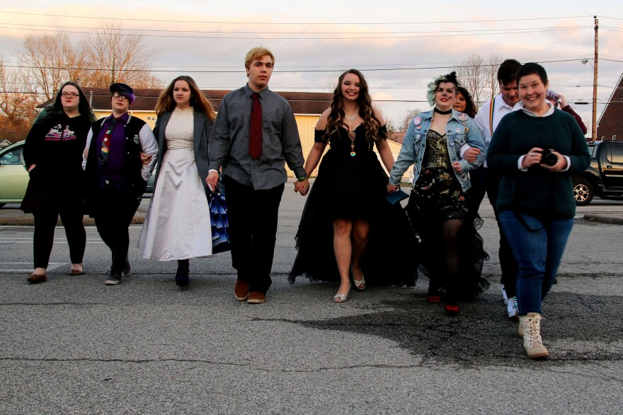 A group of teens walks on the campus of West Virginia State University to the Rainbow Formal, the state's first LGBTQ prom.