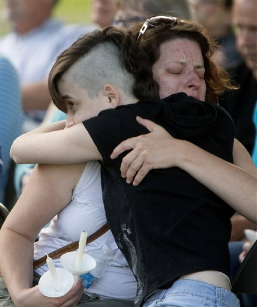 Becky Murphy hugs her daughter Lauren on Monday June 13, 2016, during a vigil at Congregational United Church of Christ in North Canton, Ohio, for the victims of the shootings at a gay nightclub in Orlando, Fla.