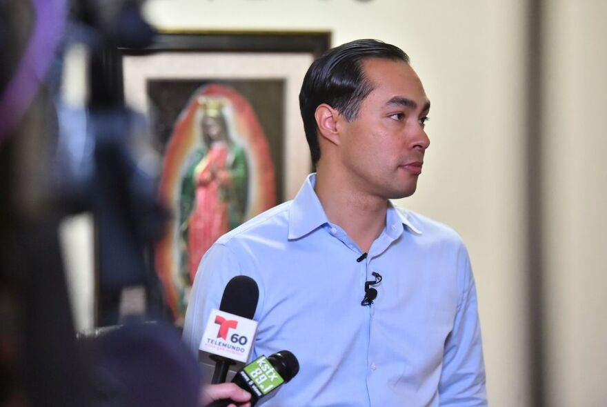 Former U.S. housing secretary and San Antonio mayor Julián Castro talks to reporters about his potential run for president in 2020. Castro held the press conference in his home in San Antonio on Dec. 12, 2018.