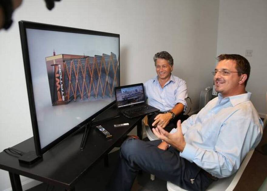 Chief Marketing Officer William Berenson and co-founder Ludovic Roche show a PWRstation on the screen while at work at the Lab in Wynwood.