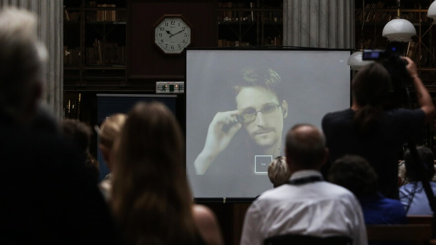 National Security Agency leaker Edward Snowden speaks via video link during the Athens Democracy Forum, organized by <em>The New York Times</em>, at the National Library in Athens on Sept. 16, 2016. Snowden is in exile in Moscow; Russia has extended his residence permit.