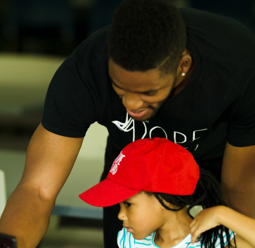 Johnson enjoys teaching his daughter about entrepreneurship. He also lets her voice her opinion about his brand, Dope Dad.