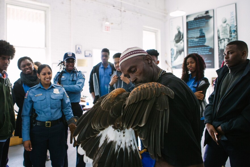 Rodney Stotts talks with students as part of a D.C. police program to expose youth to career and community service opportunities.
