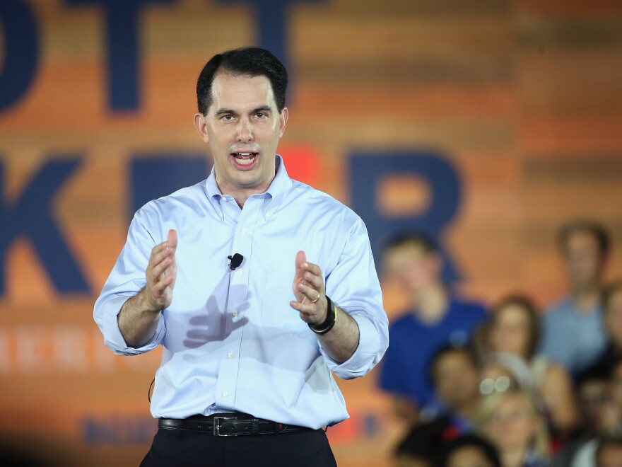 Wisconsin Gov. Scott Walker (wearing a shirt that may or may not have been purchased at Kohl's) announces that he will seek the Republican nomination for president.
