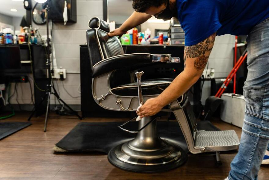 Barber wiping down chair