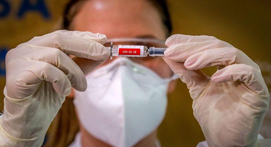 A nurse shows a COVID-19 vaccine produced by Chinese company Sinovac Biotech at the Sao Lucas Hospital, in Porto Alegre, southern Brazil.