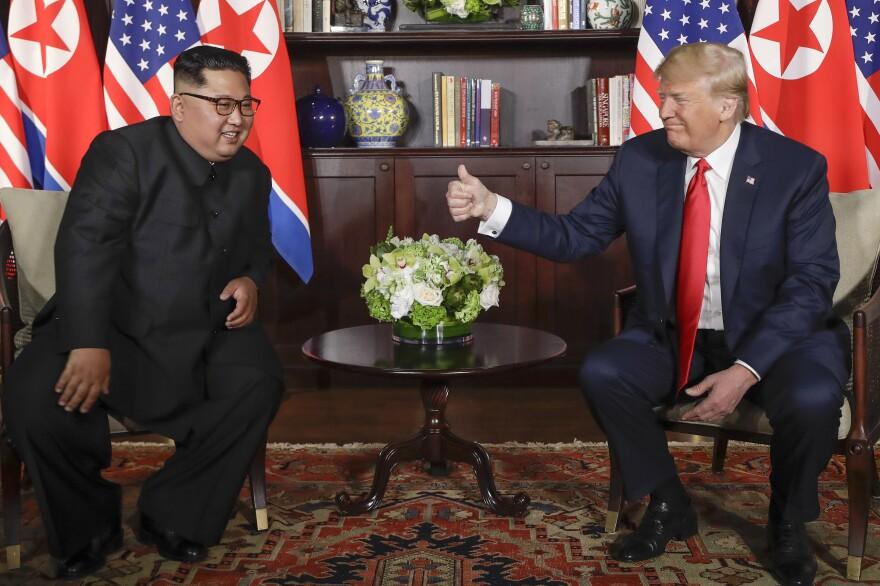 President Trump gives North Korean leader Kim Jong Un a thumbs up at their meeting.
