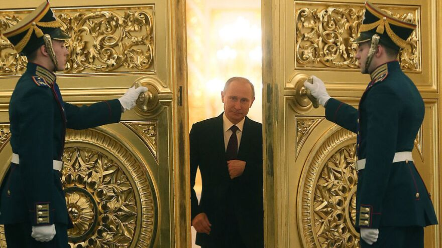 Russian President Vladimir Putin enters the St. George Hall of the Grand Kremlin Palace in Moscow.