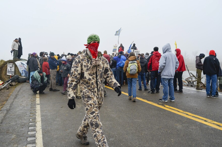 Protesters surround the Rev. Jesse Jackson on Highway 1806 on Thursday.