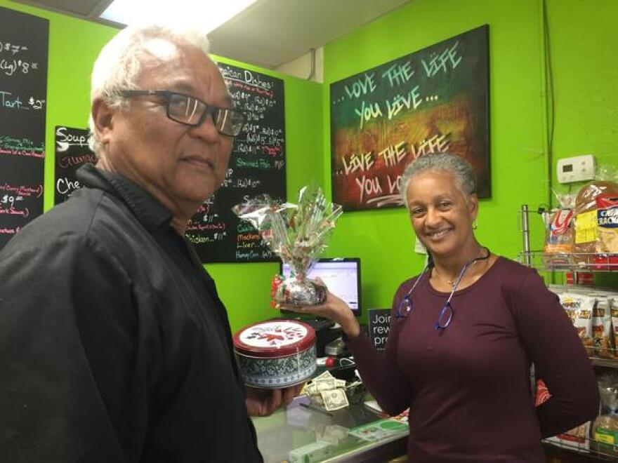 Maurice and Marcia Chang with some of the Christmas black cakes they offer at their Jamaican restaurant Jamrock in Kendall.