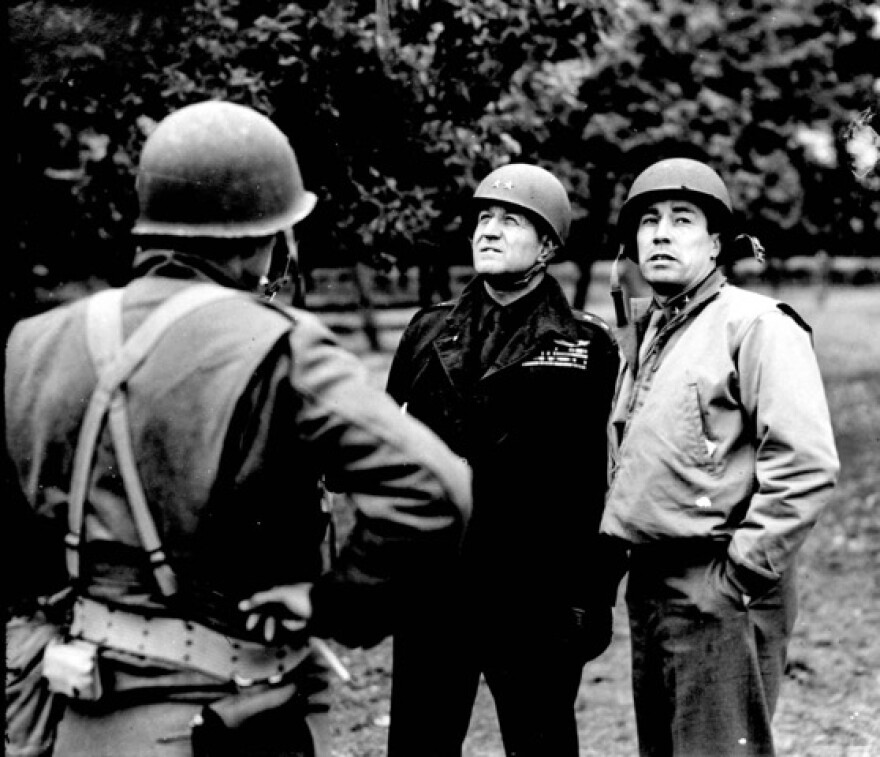 """General """"Pete"""" Quesada, far right with General Ralph Royce."""