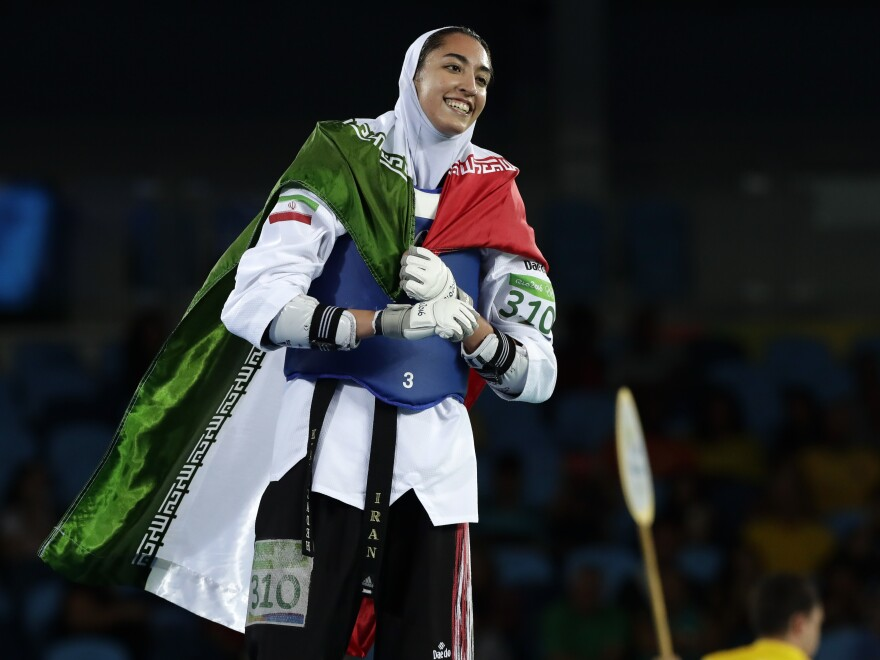 Kimia Alizadeh of Iran celebrates after winning a bronze medal in taekwondo at the 2016 Summer Olympics in Rio de Janeiro, Brazil. She says she is defecting from Iran to escape oppression.