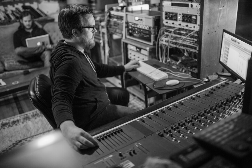 Ben Majchrzak is seen at work behind the console at Native Sound recording studio in St. Louis. Majchrzak started an ad hoc grant program to funnel cash payments to musicians who are out of work because of coronavirus concerns.  [3/18/20]