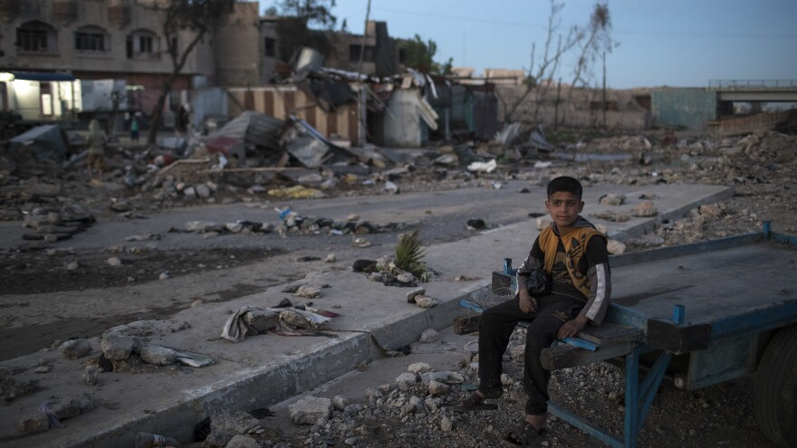 A boy in West Mosul on Wednesday in a neighborhood taken by Iraqi forces from ISIS militants.