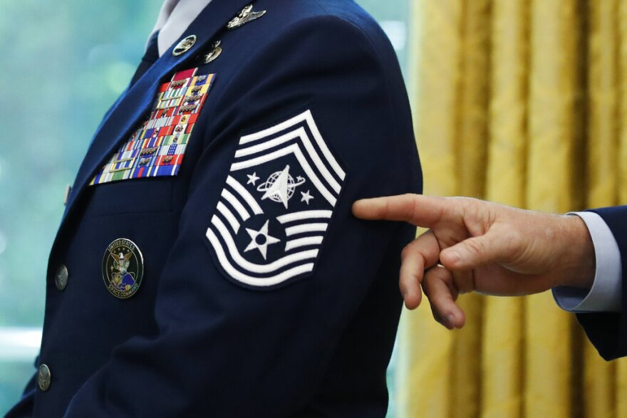 Chief Master Sgt. Roger Towberman displays his insignia during a presentation of the United States Space Force flag in the Oval Office of the White House in Washington. (AP Photo/Alex Brandon, File)