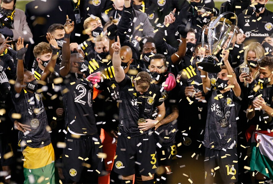 Columbus Crew players raise the trophy after defeating the Seattle Sounders 3-0 in the MLS Cup championship game Saturday, Dec. 12, 2020, in Columbus.