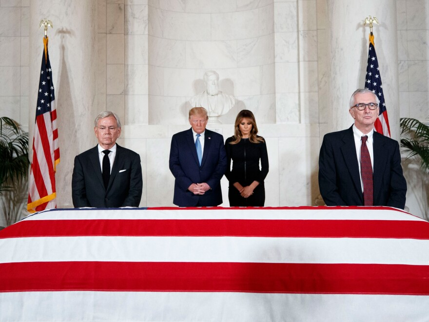President Trump and first lady Melania Trump view the casket.