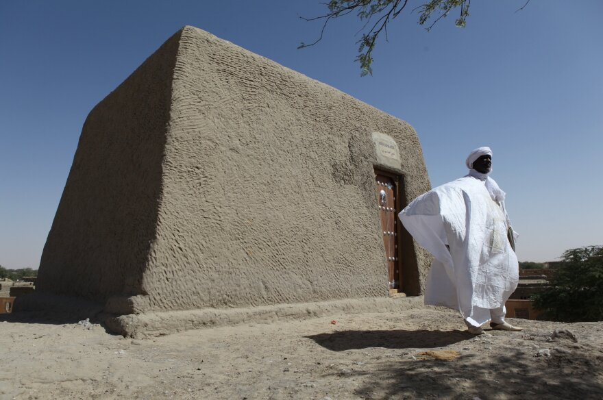 Sane Chirfi, representing the family that looks after the mausoleum of Alpha Moya, poses in front of the mausoleum on Feb. 4 in Timbuktu. Historic mausoleums, destroyed during an Islamist takeover of northern Mali in 2012, were rebuilt thanks to the U.N. cultural agency UNESCO.