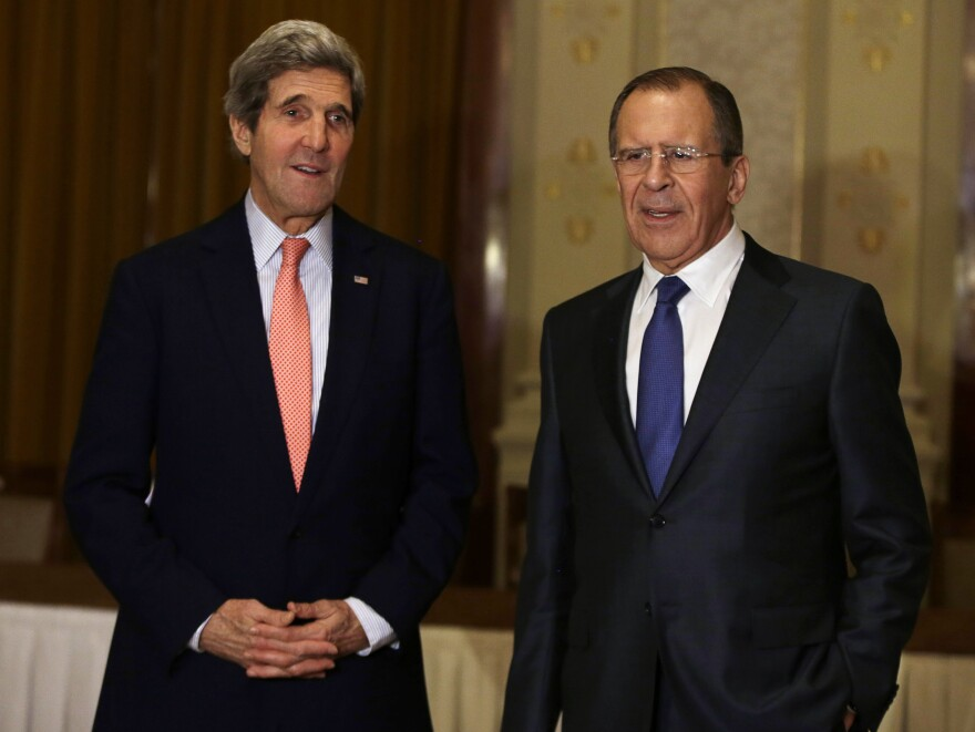 Secretary of State John Kerry (left) meets Russia's Foreign Minister Sergey Lavrov in Montreux, Switzerland, on Tuesday, a day before the start of a major Syrian peace conference that 40 countries will attend.