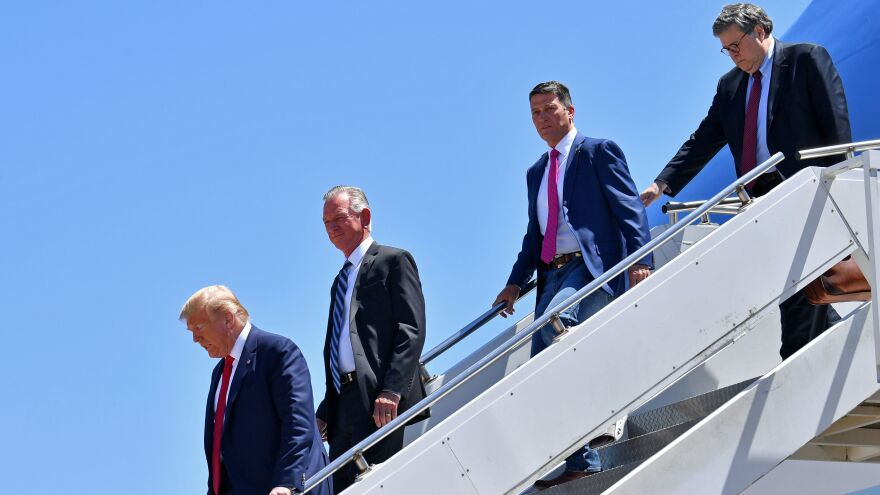 On June 11, Tuberville (second from left) joined Trump and others on a trip to Dallas.