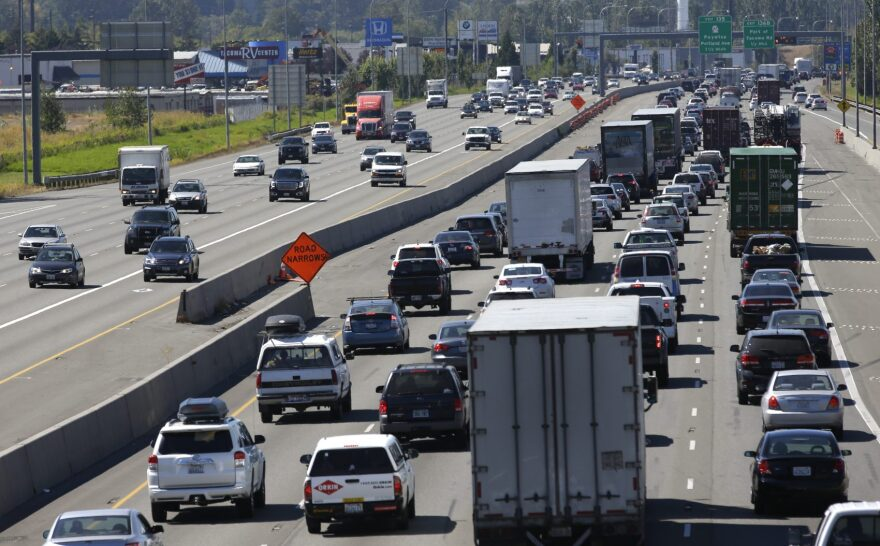 Truck and automobile traffic mix on Interstate 5, headed north through Fife, Wash., near the Port of Tacoma in 2016. (Ted S. Warren/AP)
