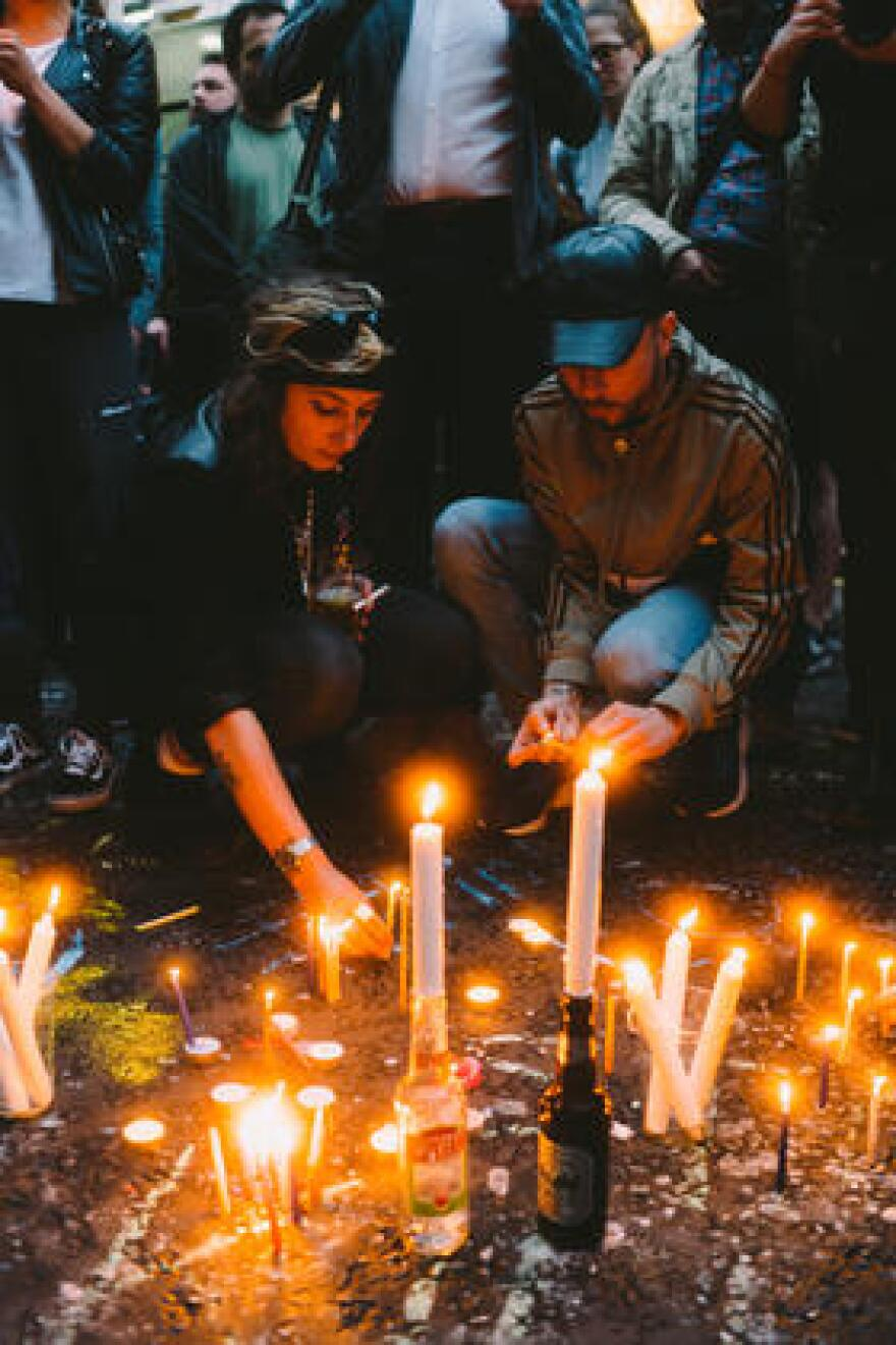 Mourners in London light candles for the victims of the mass shooting at a gay nightclub in Orlando.