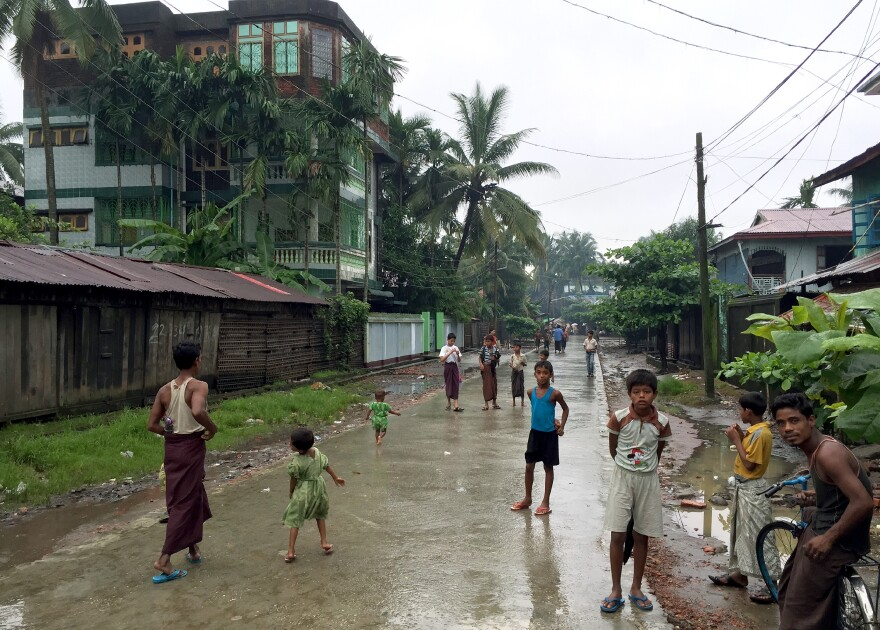 Residents stand at the entrance of Aung Mingalar, a Rohingya quarter of Sittwe, the capital of Rakhine State in western Myanmar. All but 4,000 of the neighborhood's 15,000 mostly Rohingya residents either fled or were forced to move to internment camps after violence between Buddhists and Muslims in 2012 killed about 200 people.