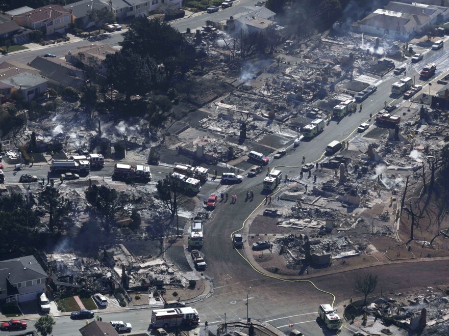 A Sept. 10, 2010 photo showing firefighters and rescue crews working amid damage caused by the pipeline explosion in San Bruno, Calif.