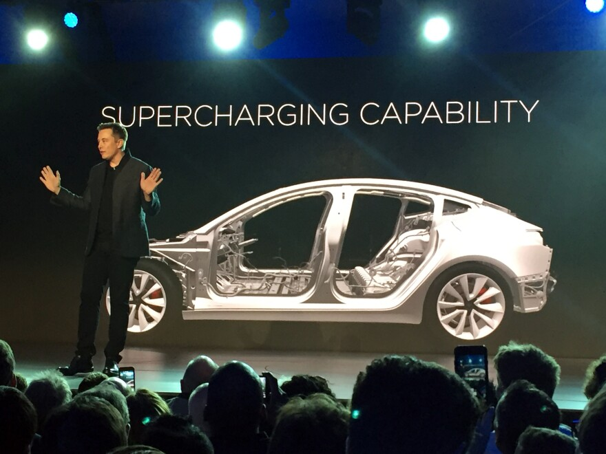 Tesla Motors CEO Elon Musk speaks at the unveiling of the Model 3 in Hawthorne, Calif., on March 31, 2016. The first Model 3 is due to roll off the assembly line Friday.