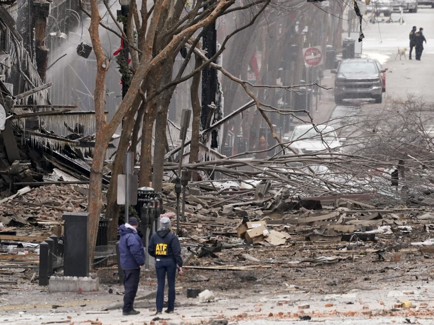 Emergency personnel work near the scene of an explosion in downtown Nashville, Tenn., on Dec. 25.