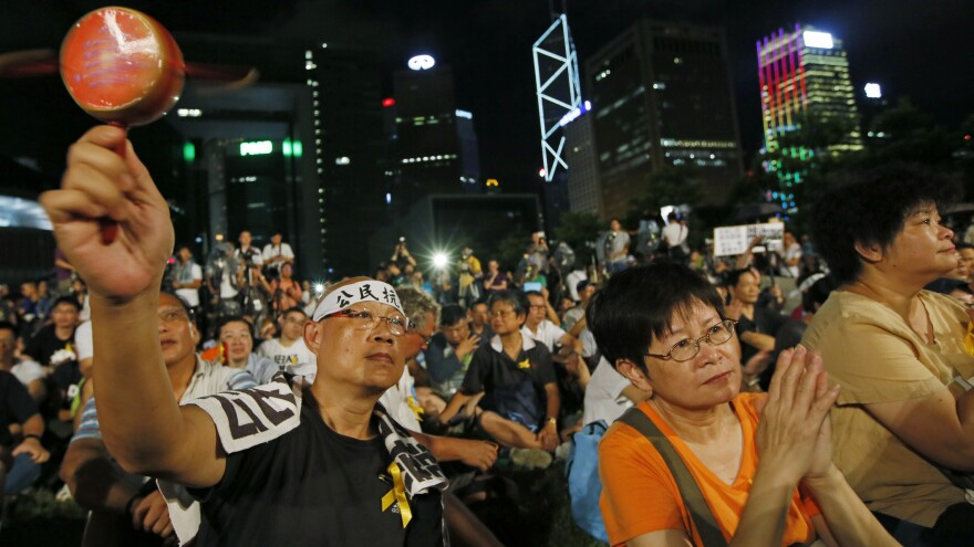 Protesters attend a rally in Hong Kong on Sunday after China's National People's Congress denied open elections for the next chief executive. Many in Hong Kong feel their freedoms are eroding under mainland political pressure.