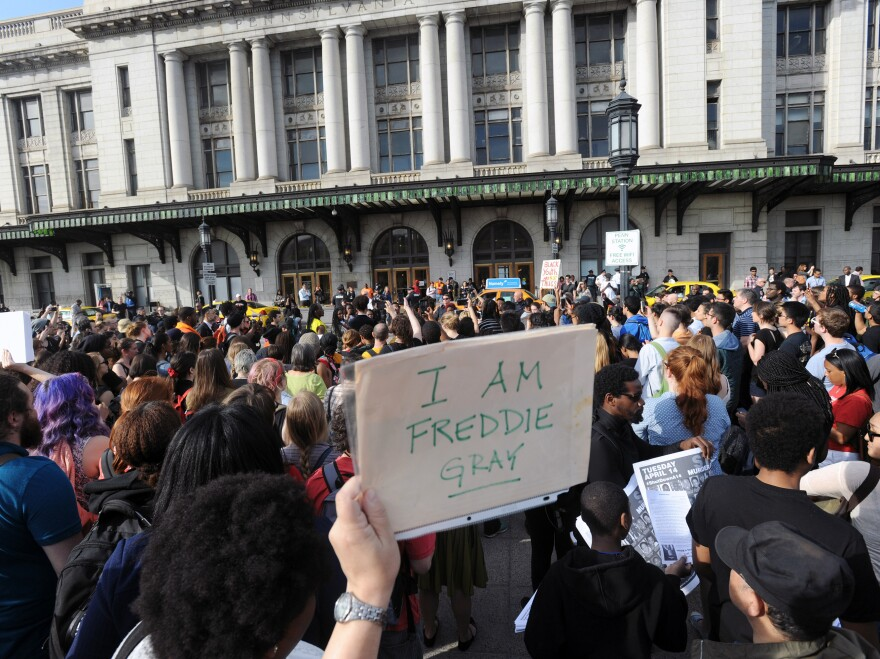 Demonstrators gather at Pennsylvania Station to march to Baltimore City Hall on Wednesday over the death of Freddie Gray. A Baltimore Police Department task force handed over its investigation into Gray's death to the state's attorney's office.