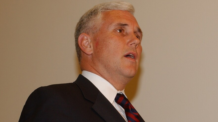 Then-Rep. Mike Pence talks to reporters on Capitol Hill on May 12, 2004, after viewing new photographs and videos of Iraqi prisoner abuse.