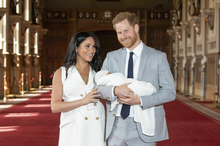 Britain's Prince Harry and Meghan, Duke and Duchess of Sussex, hold their newborn son in St. George's Hall at Windsor Castle on Wednesday. Archie Harrison Mountbatten-Windsor was born Monday morning.