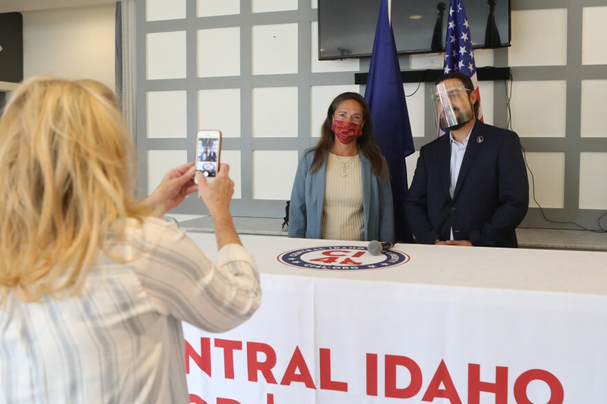 Parker and Idaho State Sen. Michelle Stennett pose for a photo before their debate in Hailey, Idaho, on Sept. 17. Parker is running as a Republican against the longtime Democratic incumbent.