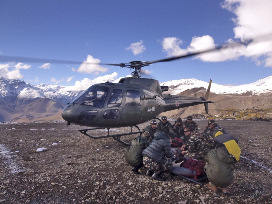 Soldiers prepare to airlift an avalanche victim Wednesday in the area of Thorong La pass in Nepal. Authorities now say the death toll from a freak blizzard and avalanches in the Himalayas has reached 27.