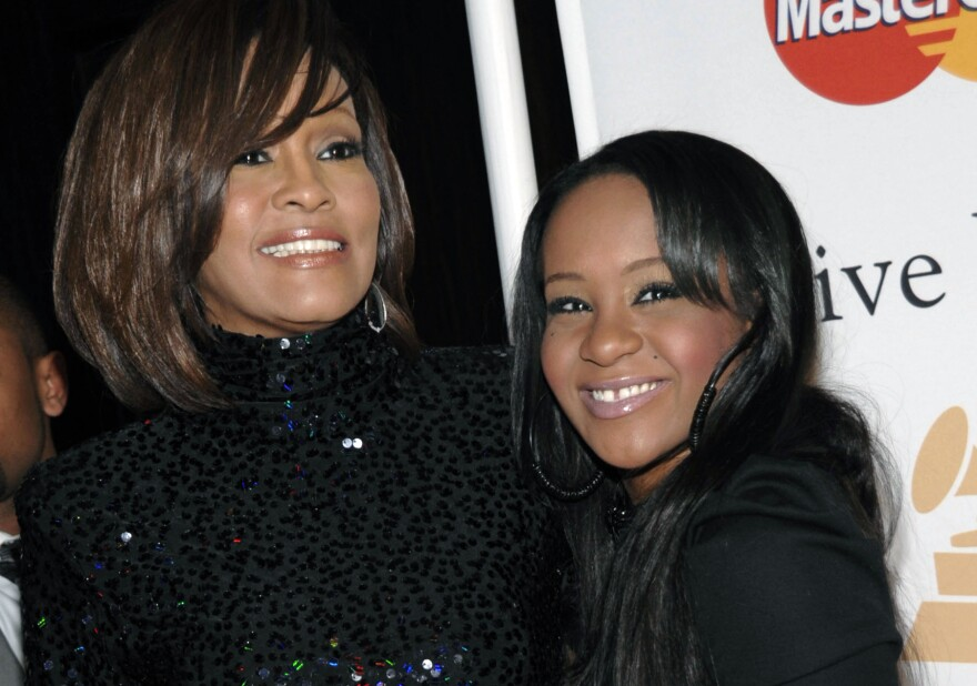 Singer Whitney Houston and daughter, Bobbi Kristina Brown, arrive at a 2011 event in Beverly Hills, Calif.