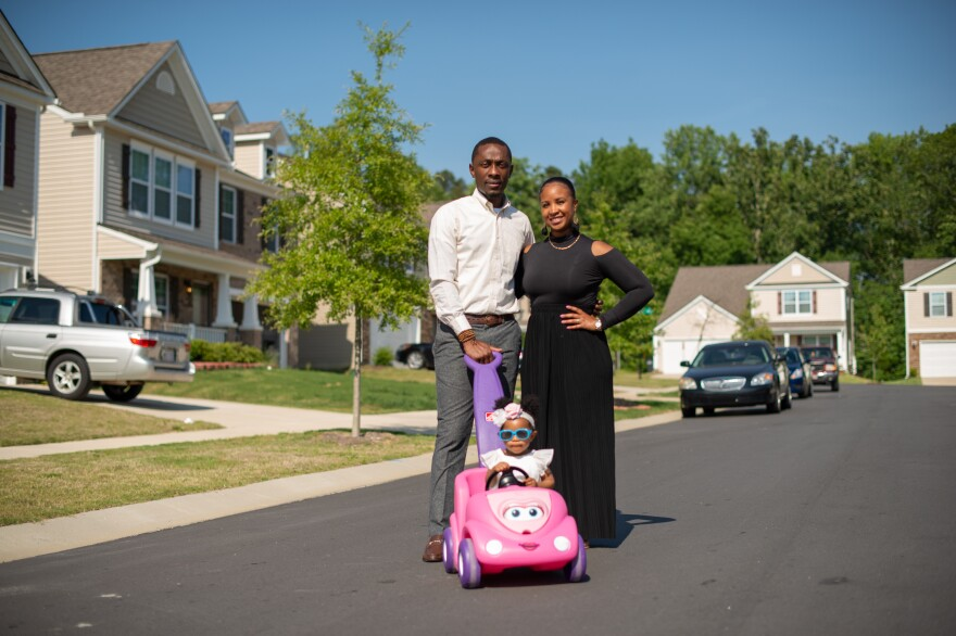 Sam Smith, Brittany Smith and their daughter Erelah outside their Charlotte home. The Smiths moved to Charlotte looking for change and opportunity. They are part of an influx of African Americans to Mecklenburg County, where the African American population has ballooned by 64% since 2000.
