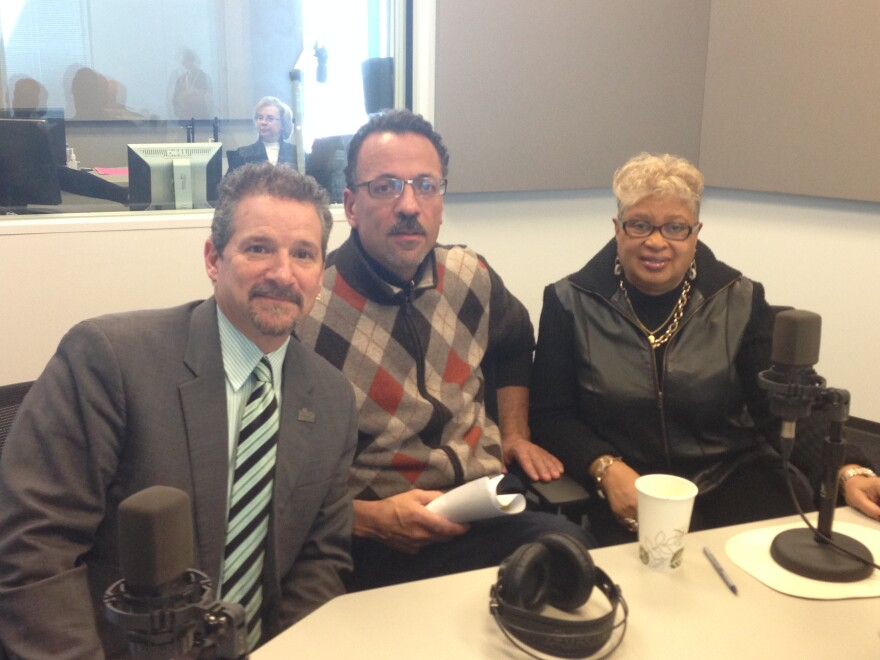 Beyond Housing CEO Chris Krehmeyer, left, Normandy Mayor Patrick Green and Cool Valley Mayor Viola Murphy pose for a photo after talking about municipality government with 'St. Louis on the Air' host Don Marsh on Feb. 5, 2015.