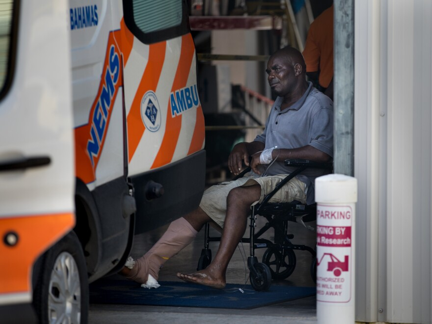 An injured man is evacuated from Marsh Harbour to Nassau, Bahamas, after surviving Hurricane Dorian on Wednesday.